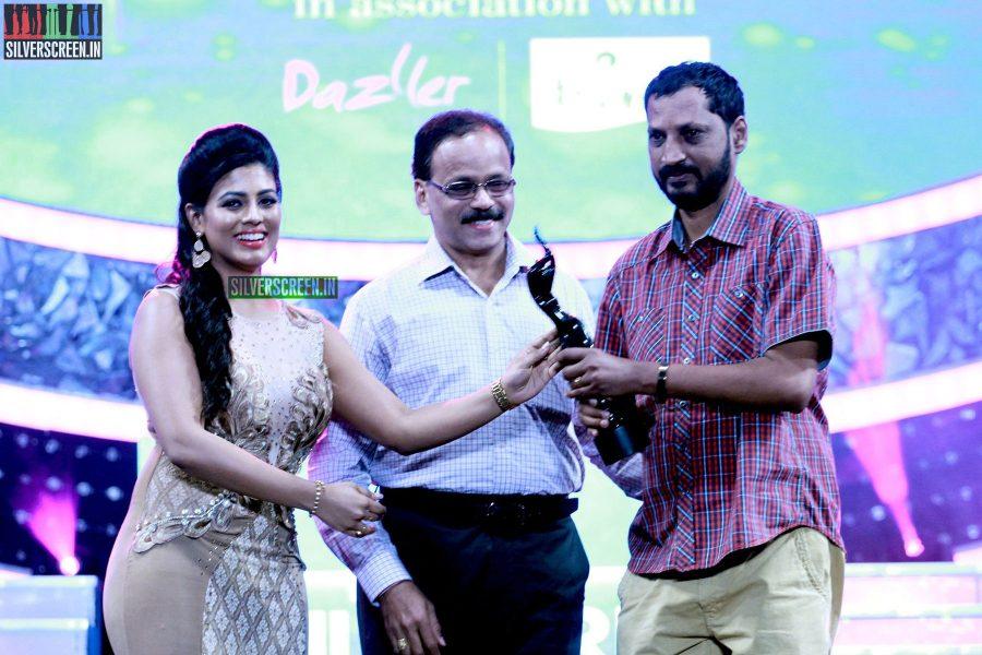 G Dhananjayan, Iniya and Na Muthukumar at the 62nd Filmfare Awards South Photos