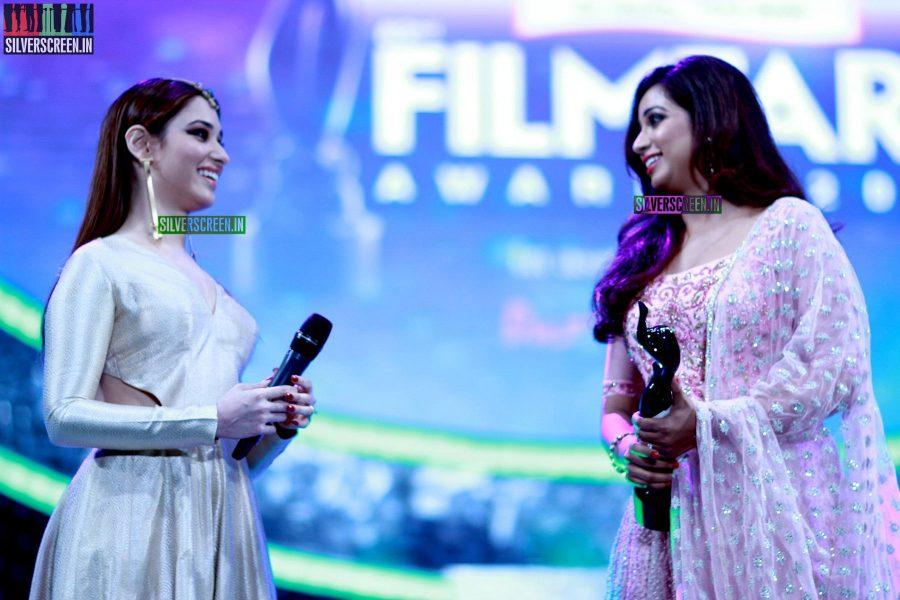 Tamanna and Shreya Ghoshal at the 62nd Filmfare Awards South Photos