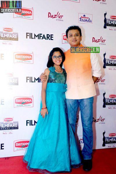 Unni Krishnan and Uthra Unnikrishnan at the 62nd Filmfare Awards South Photos