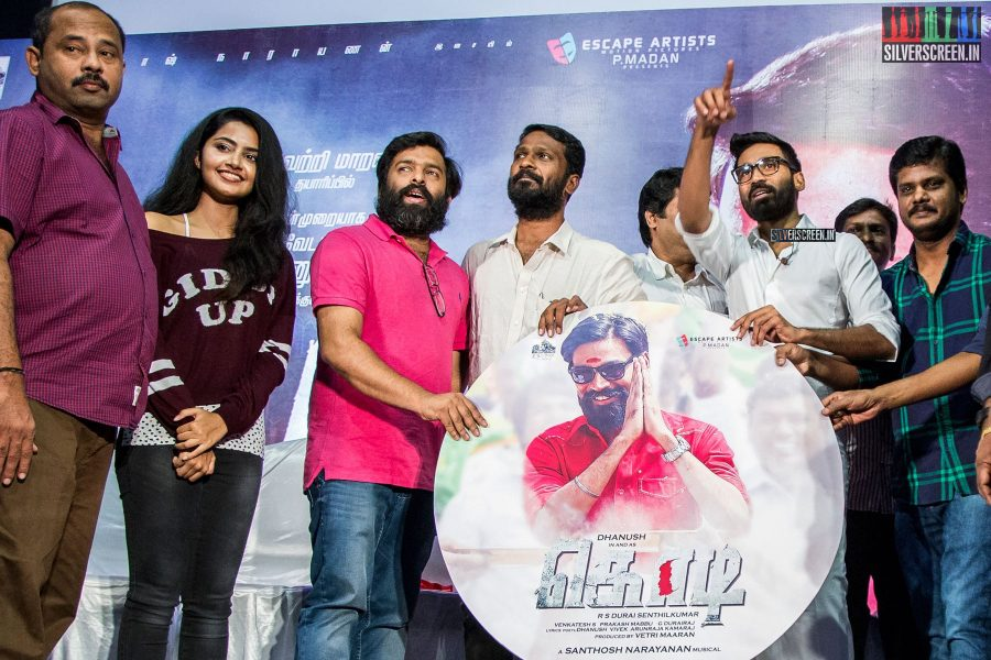Dhanush proved to be quite adept at the PR game. Here; he guides his team through the 'group photo' stage of the press meet.
