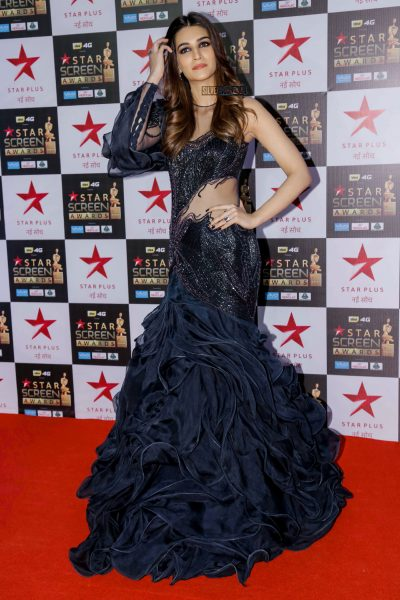 Kriti Sanon in a one-shouldered Gaurav Gupta gown with jewellery by Aurelle.