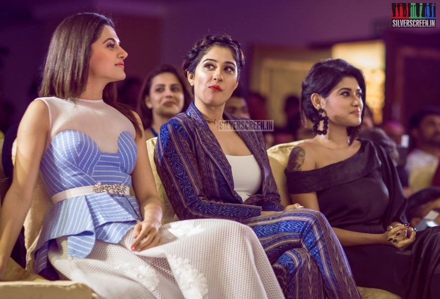 Regina Cassandra contemplates something at a calendar launch event.