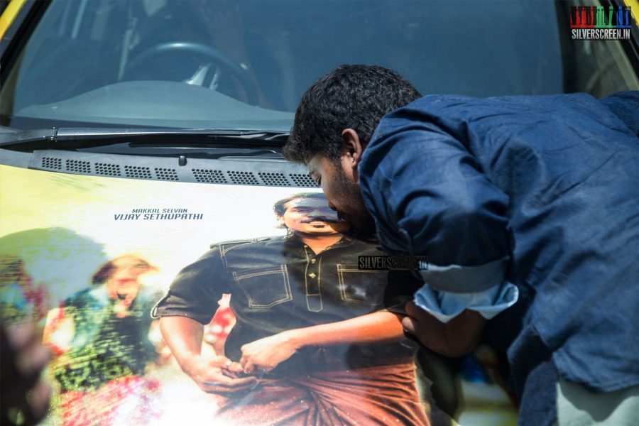A fan kisses a poster of Vijay Sethupathi at the press meet for <em>Junga.</em> The screenshot of a now famous Facebook conversation between director Karthik Subbaraj and an unknown user speaks volumes about the actor's massive growth – all in a span of eight years.